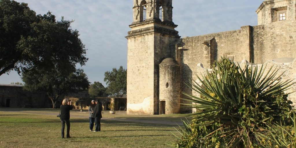 Tourist pilgrims at Mission San José in San Antonio, Texas