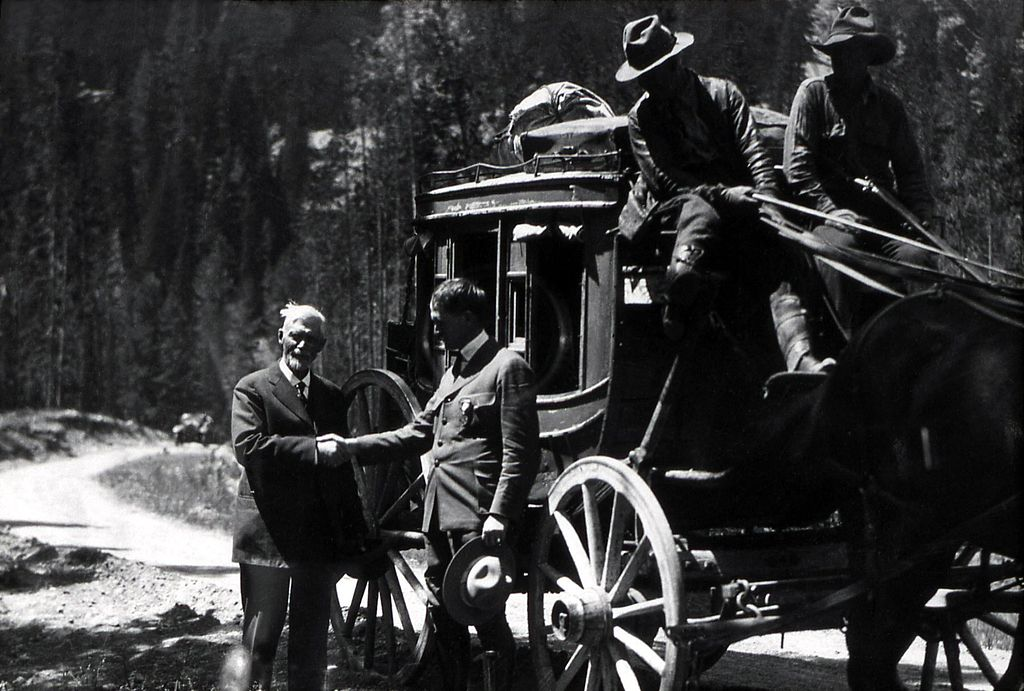 Horace Albright greets C.W. Cook beside a stage coach