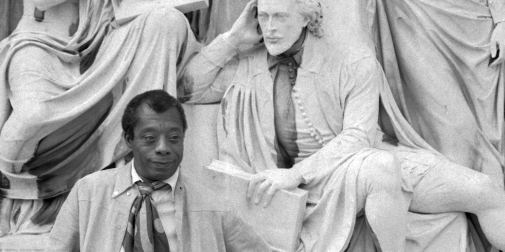 James Baldwin on the Albert Memorial with statue of Shakespeare